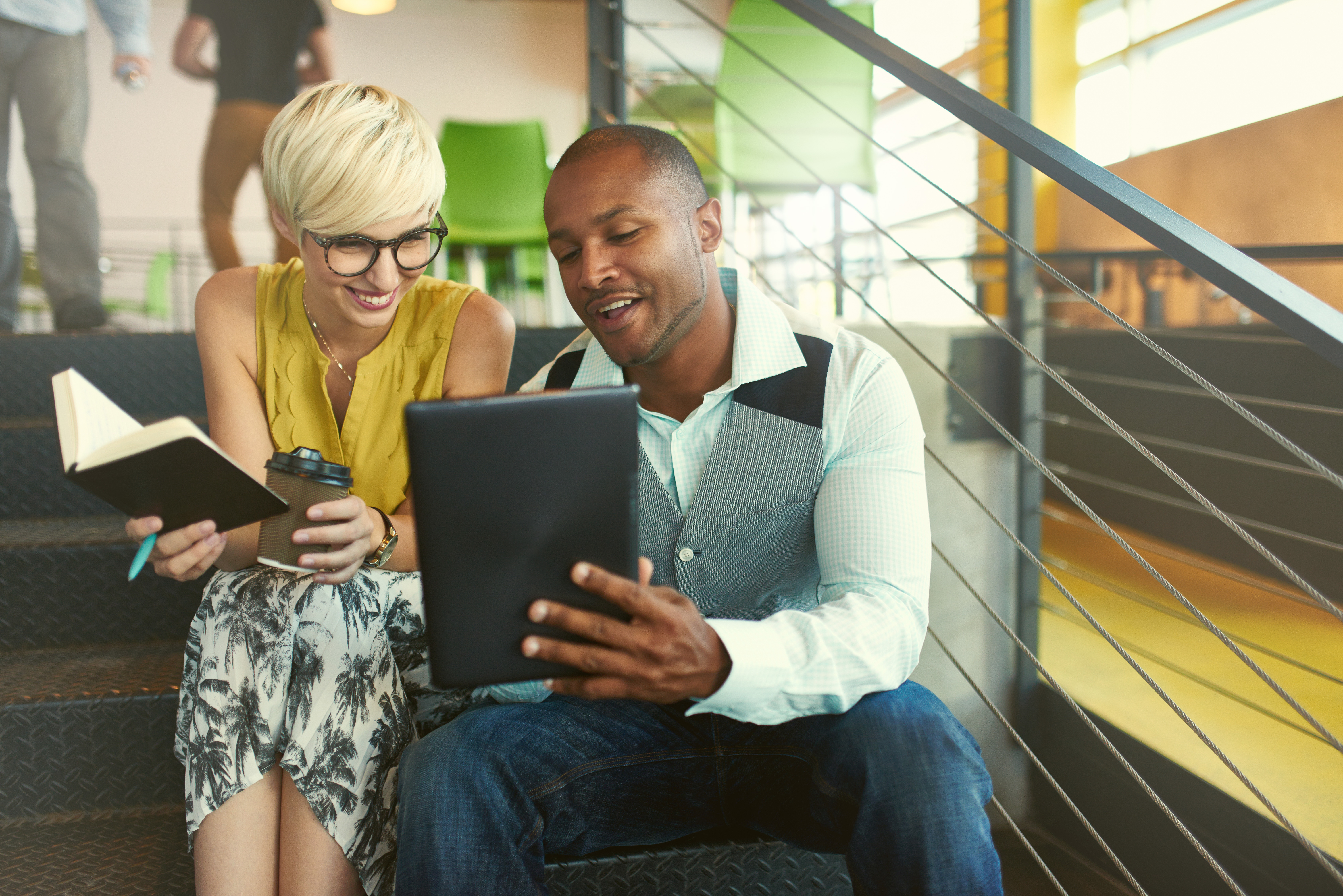 couple reviewing financial literacy on tablet